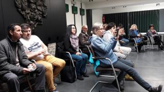 Aandachtig luisterend publiek